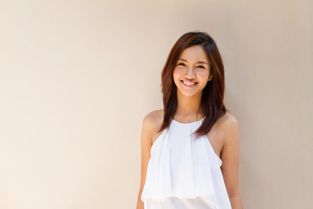 happy smiling woman in casual dress, warm tone color