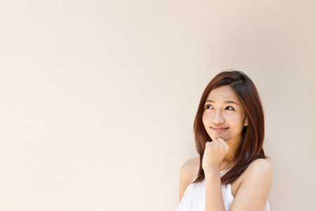happy woman looking at blank , warm brown beige color tone Stock Photo