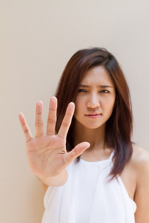 woman stop: stop, reject, refuse, forbid, negative  hand sign from beautiful woman