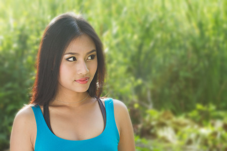 asian woman face: beautiful woman looking at nature background for text space