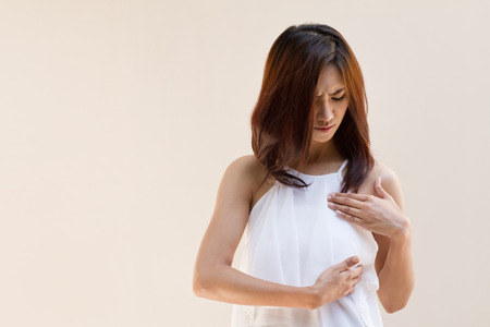 Breast Cancer woman examines her breast Stock Photo