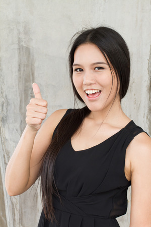 smiling woman showing thumb up photo