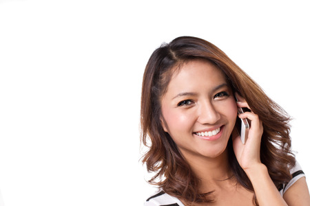 happy, positive, smiling woman talks with her cellular phone, white isolate with text space