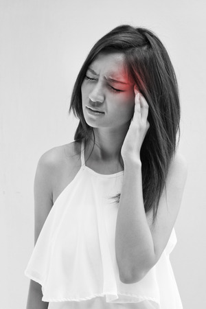 woman with headache, migraine, stress, insomnia, hangover with red alert accent photo