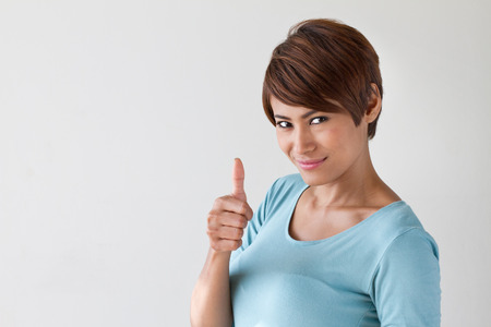 woman short hair: beautiful, attractive, friendly, smiling woman giving thumb up