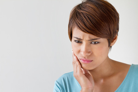 worry woman with toothache, oral problem, anxiety mood photo