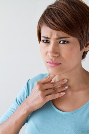 sick woman with sore throat, inflammation photo
