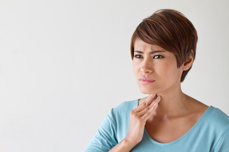 painful: sick woman with sore throat, inflammation with blank area for text or copy space Stock Photo