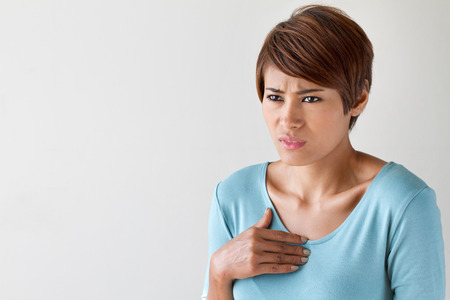 sick woman with heart attack, chest pain, health problem with blank area for text or copy space Stock Photo