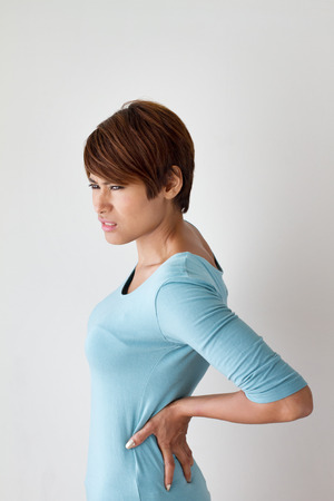 backpain: woman suffers from backpain, concept of office syndrome, spinal or lower back problem Stock Photo
