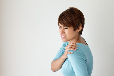 woman with shoulder pain or stiffness Stock Photo