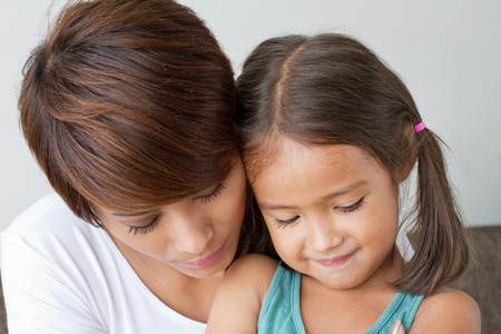 comforted: daughter comforted by her caring mother, concept of family relationship