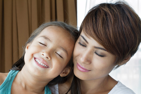 pre teen girls: portrait of happy, smiling, positive family  mother and daughter sharing loving and care