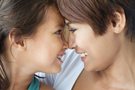 preteen asian: portrait of happy, smiling, positive family  mother and daughter sharing loving and care