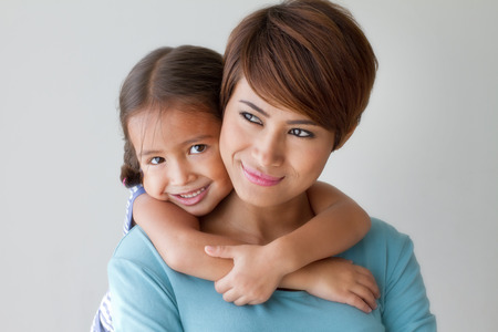 pre adult: happy family with smiling, positive daughter hugging her mother