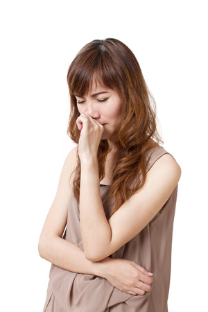 running nose: woman with cold or flu, running nose, white isolated background Stock Photo