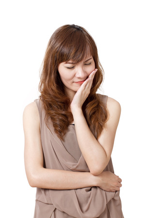 woman suffers from toothache photo