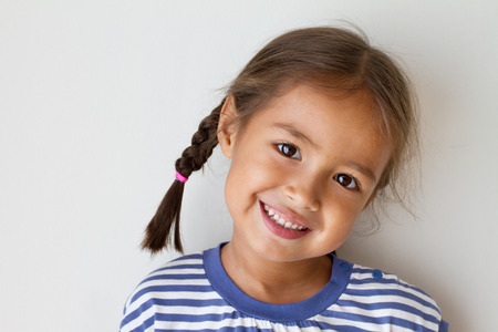 multi race: portrait of happy, positive, smiling, playful asian caucasian girl Stock Photo