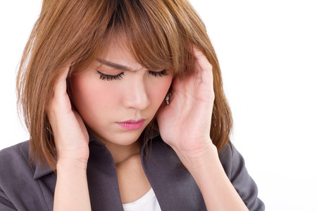 stressful business woman suffers from headache, stress, overwork, migraine on white isolated background photo