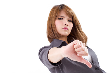 angry businesswoman giving, showing thumb down hand gesture on white isolated background, concept of not ok, rejection, unacceptance, failure, negative result photo