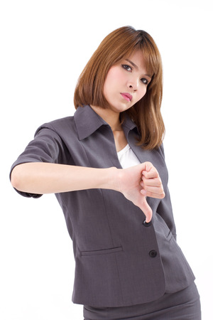 rejection sad: angry businesswoman giving, showing thumb down hand gesture on white isolated background, concept of not ok, rejection, unacceptance, failure, negative result