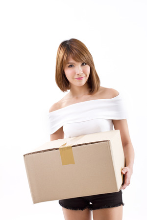 happy, smiling woman carrying carton box for moving concept photo
