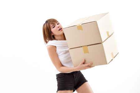 unhappy woman carrying heavy box with back pain photo