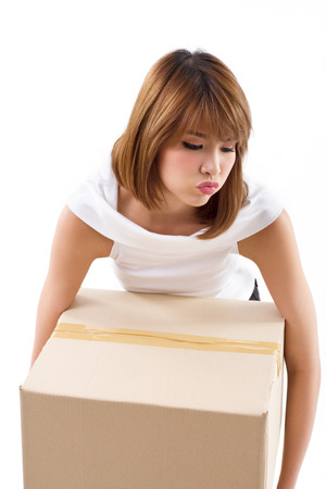 tiring, upset woman carrying heavy box with negative emotion photo