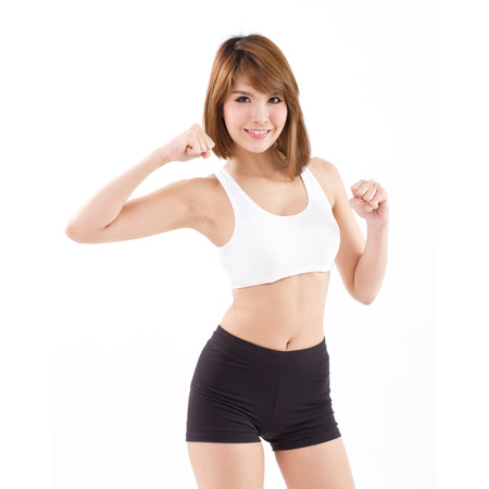 leisure wear: strong, fit, firm woman checking her arm muscle strength Stock Photo