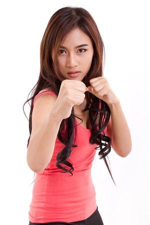 portrait of female fighter, boxer posing fighting stance