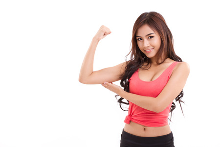 young sporty woman showing, checking her biceps arm muscle Banque d'images
