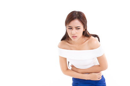 woman suffers from menstruation pain or stomach ache Stock Photo