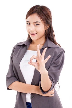 hand sign: business woman, female executive giving ok hand sign hand gesture on white background