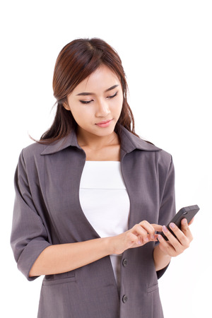 business woman using, texting with smartphone photo