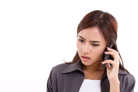 frustrated, upset, disappointed business woman talking, communicating via her smartphone photo