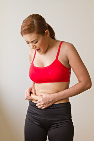 chubby: unhappy woman with excessive fat at her waist