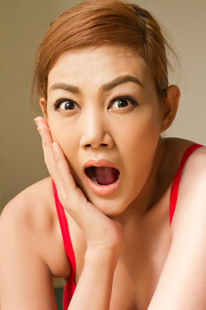woman open mouth: portrait of excited, surprised woman, jaw dropping