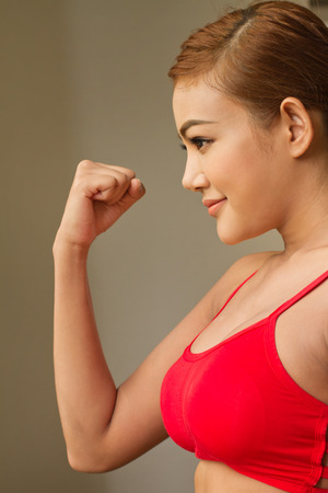 sexy asian girl: smiling, happy, positive, confident woman in red sportswear
