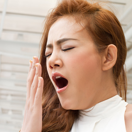 deprivation: tired, sleepy woman yawning with fatigue or insomnia