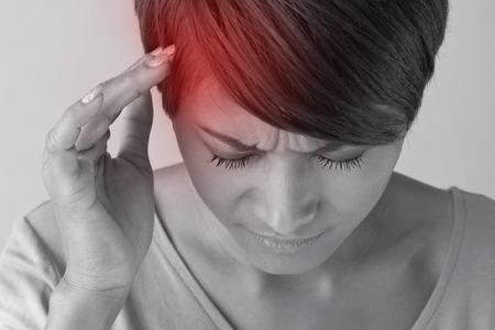 1 person: sick woman with headache. Stock Photo