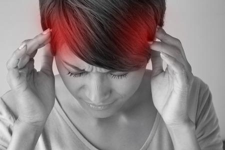 zieke vrouw met hoofdpijn. Stockfoto