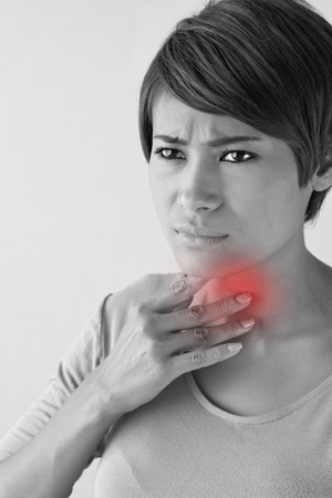 contagion: sick woman with sore throat. Stock Photo