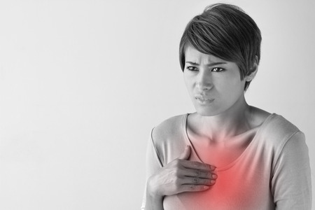 sick woman with chest pain.