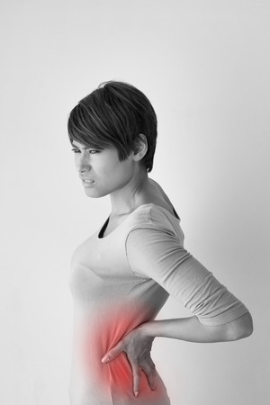 woman suffers from backpain, concept of office syndrome, spinal or lower back problem