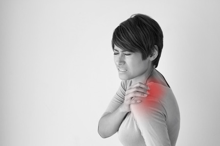 working stiff: woman with shoulder pain or stiffness Stock Photo