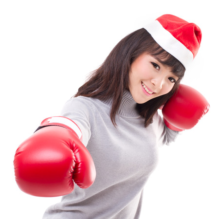 happy, smiling woman wearing christmas santa hat, boxing gloves, xmas and boxing day concept photo