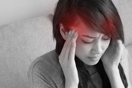 woman with headache, migraine, stress, insomnia, hangover, asian caucasian indoor scene photo