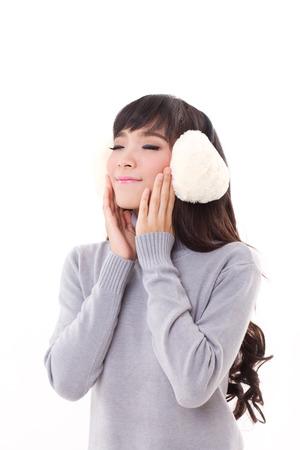 Earmuffs: happy, smiling, joyful woman with earmuffs