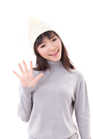 five fingers: happy, smiling, joyful woman wearing knit hat, showing 5 fingers hand sign Stock Photo
