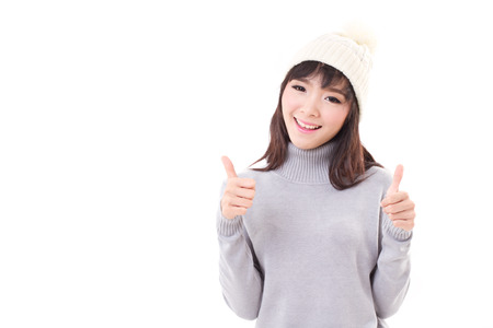 woman sweater: happy woman giving two thumbs up, fall or winter dress